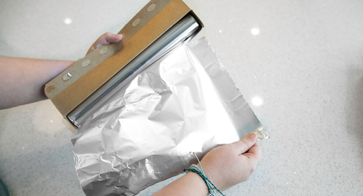 Someone tearing off a sheet of foil