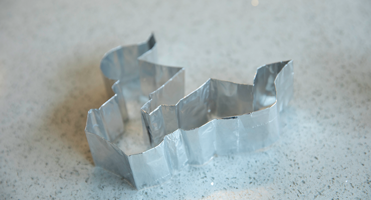 Closeup image of the Bull U cookie cutter laying on the counter