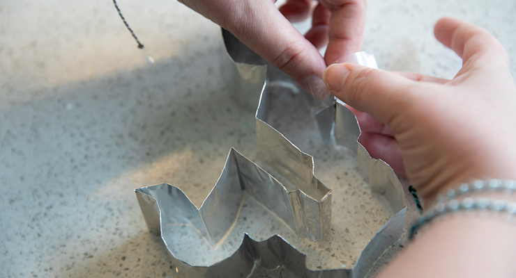 The cookie cutter ends are fastened with tape to complete the shape