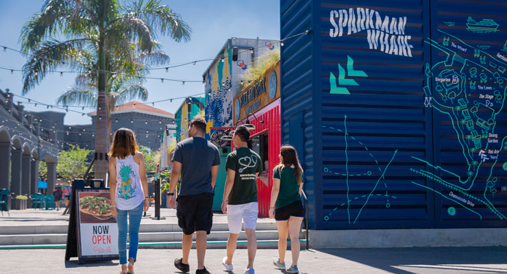 A group of students entering Tampa's Sparkman Wharf, a popular spot for restaurants, shops and street food stands.