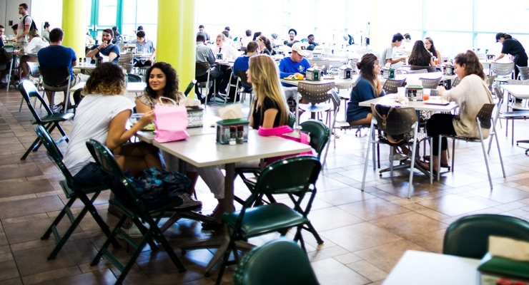 USF students hanging out, talking, and eating in a USF dining hall.