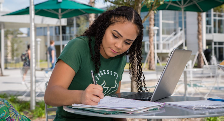 Image of USF student writing a list of priorities