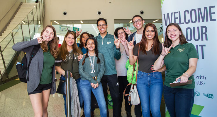 USF staff and prospective students and family members attend an event at USF.