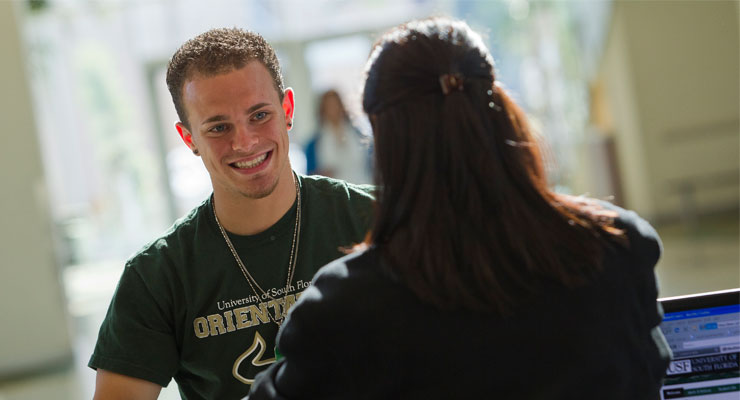 USF Orientation team member talking to a new USF student during orientation.