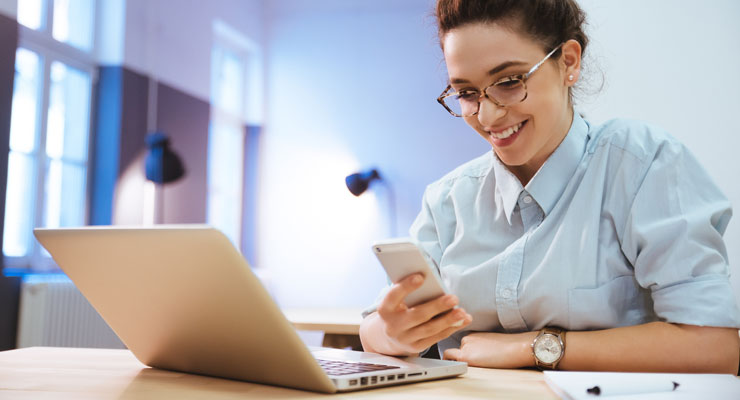 female student uses a smart phone app to make studying fun