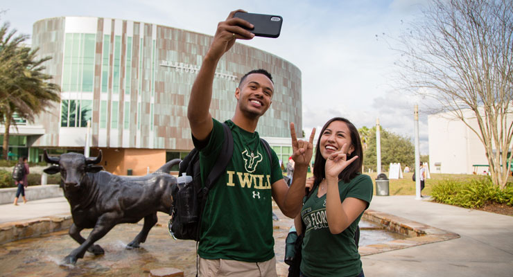 USF students taking a selfie outside of the Marshall Student Center
