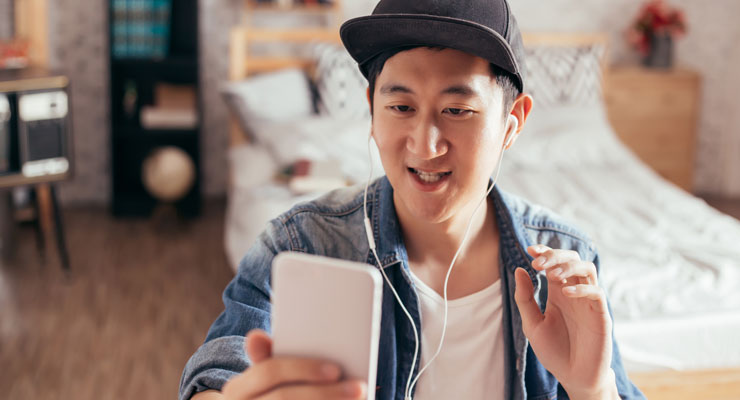 asian american student celebrates his virtual high school graduation at home on Facetime