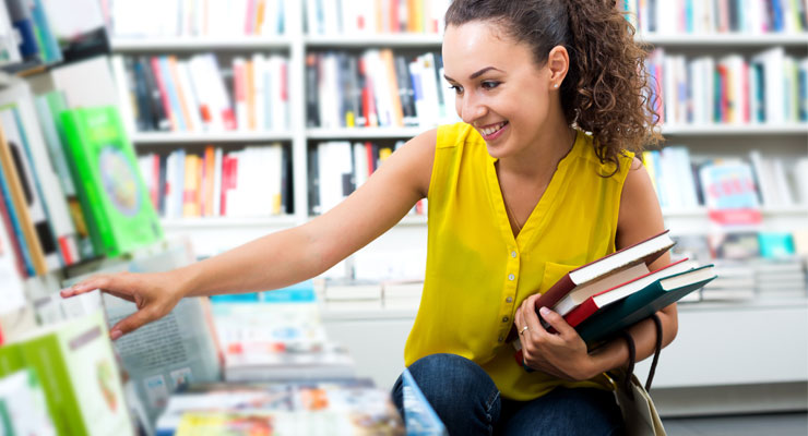 High school student finding books in the library