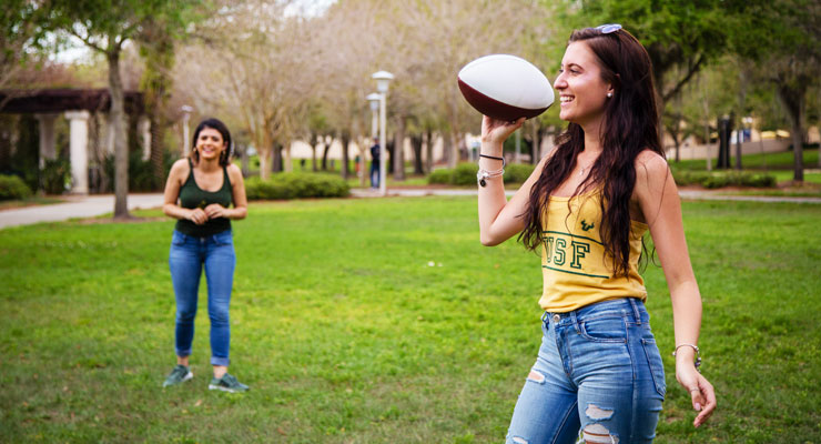 USF students enjoying a day outside playing football.