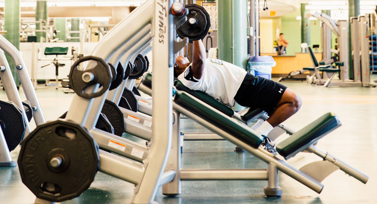 USF students practicing stress relief techniques by working out in the gym.