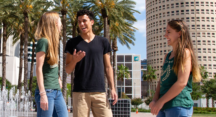 Three USF students using the life skill of making friends in downtown Tampa.