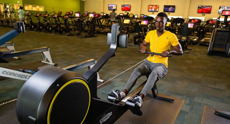 A USF student practices the life skill of staying healthy by working out at the Campus Recreation Center.