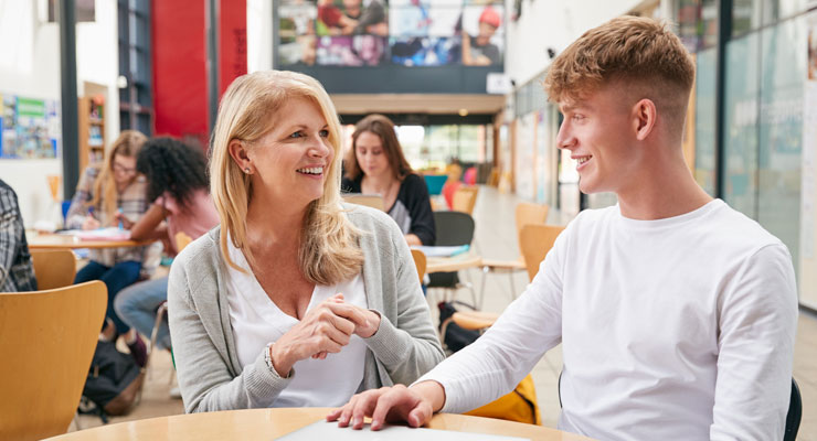 Student talking to a counselor on campus