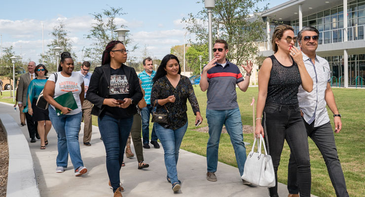 Parents and students walking through USF on a tour