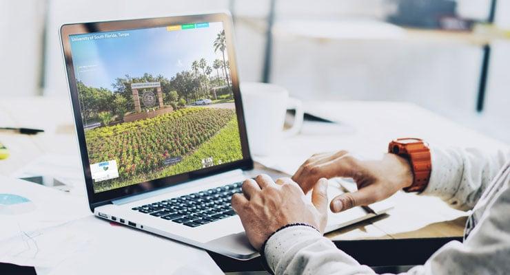 Someone takes the USF virtual tour on their laptop