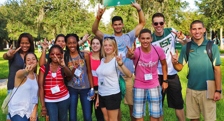 A group of high school students taking an on-campus tour of USF