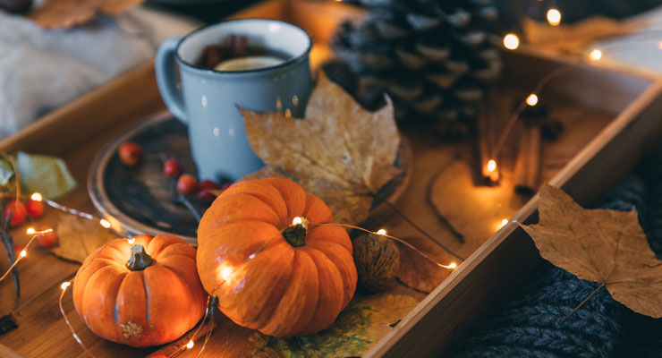 Hot chocolate, pumpkins, leaves, and other fall decorations