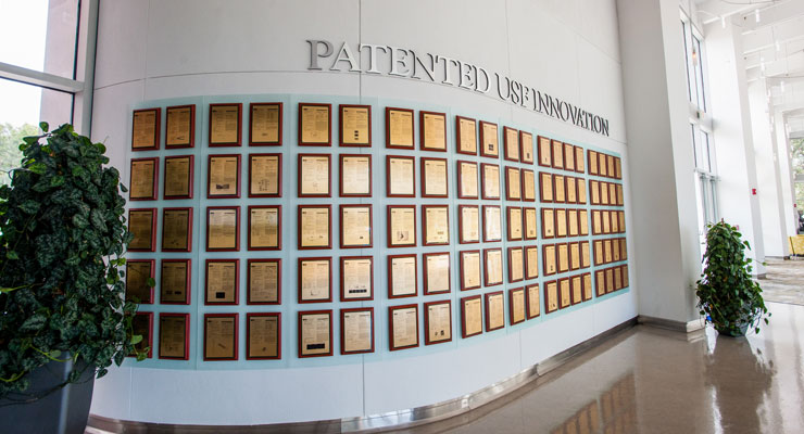 The USF Research & Innovation wall of patents recognizing research breakthroughs