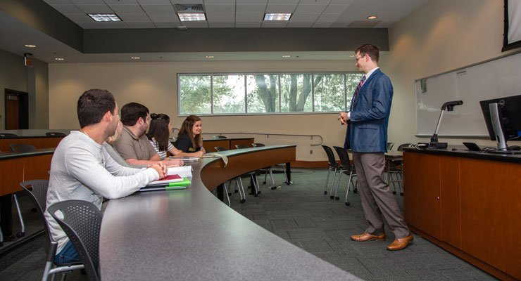 USF students in a small class have an in-depth discussion about the lesson with the teacher.