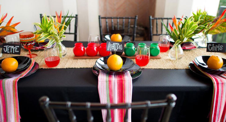 A colorful dining room table set for a Kwanzaa celebration