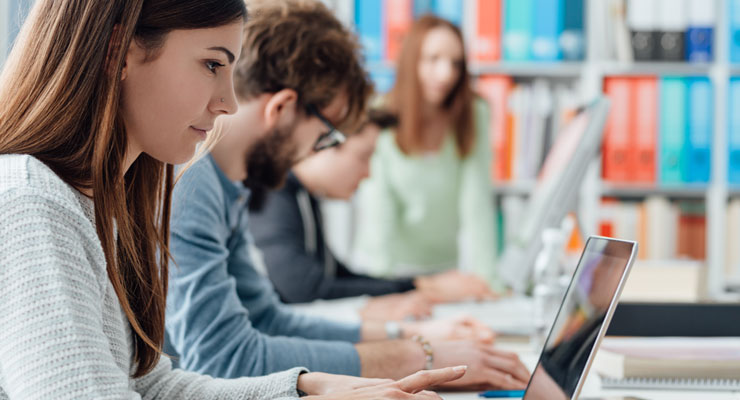 Students work on applications on their computers.