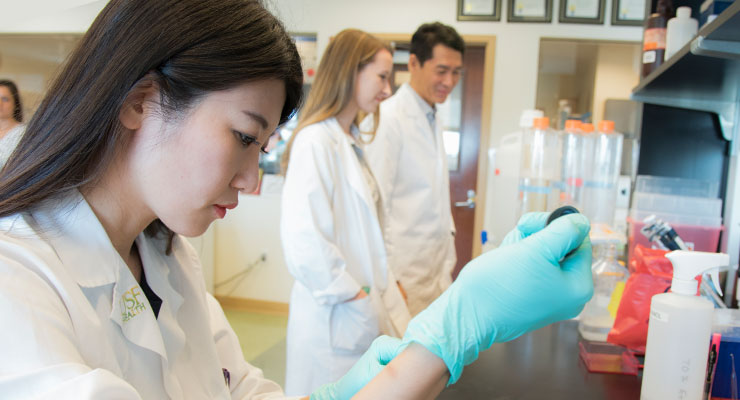 USF students in a health or medical type major in the lab