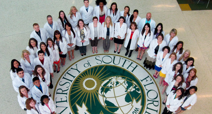USF students in a health or medical type major during a white coat ceremony
