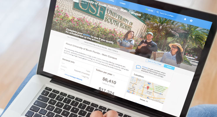 A student reviews USF tuition and fees on a laptop computer