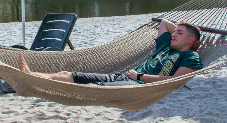 USF student taking a nap in a hammock.