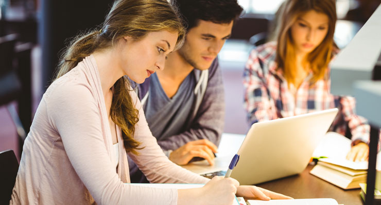 Three college students study together for a test.