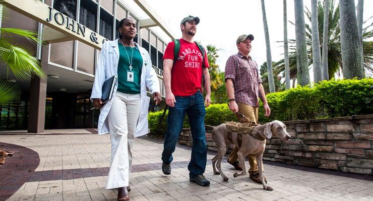 USF veterans walk through campus with an advisor.