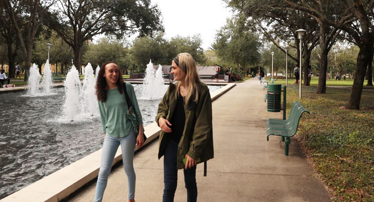Two USF students take a walk at the MLK Plaza.
