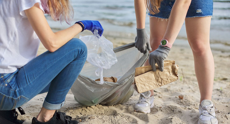 Two female students spend their gap year after high school removing litter from beaches