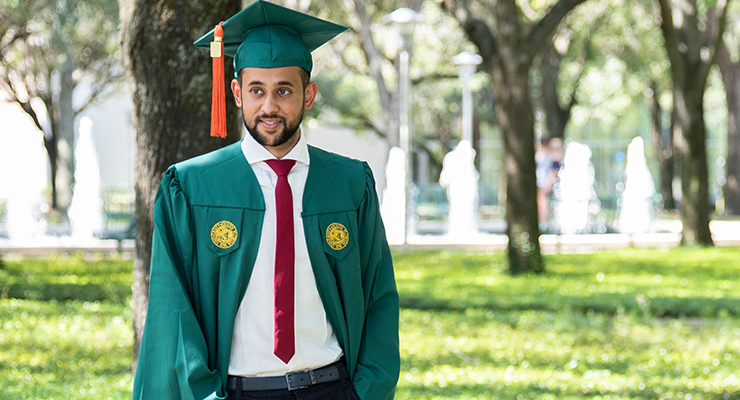 Male USF student graduating.