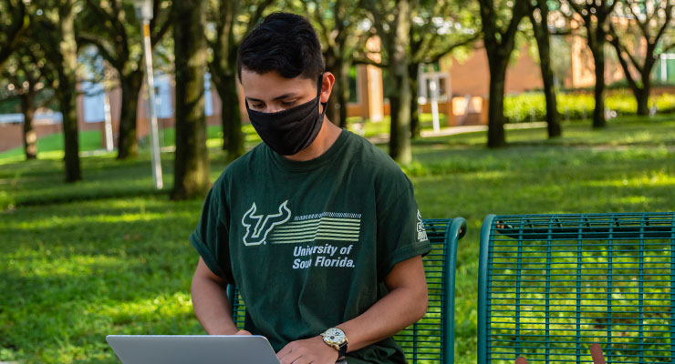 USF student researching why and how to wear face masks during covid-19 for students.