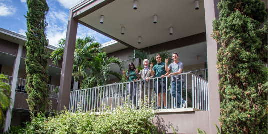 USF students exploring the campus outside on a rail.