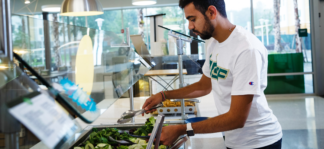 USF Tampa student getting food at one of the dining halls.