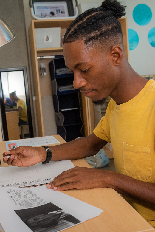 Male student studying at his apartment on the USF's St. Petersburg campus.