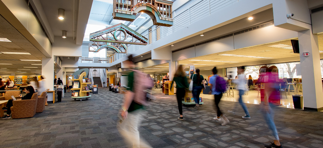 USF's St. Petersburg students walking and exploring dining options on campus.