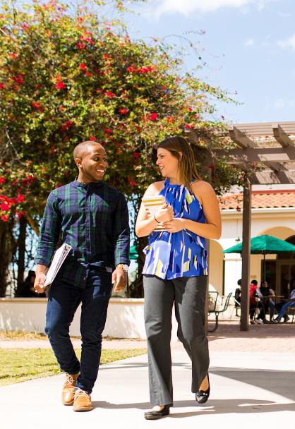 USF students walking together at the Sarasota-Manatee USF campus.
