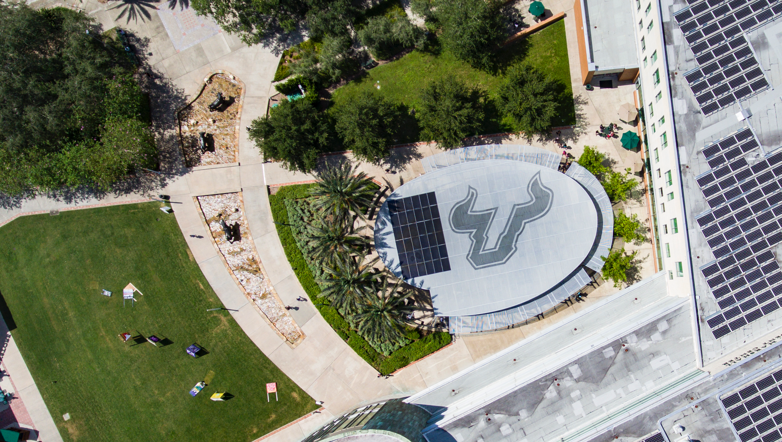 Aerial view of the USF campus showcasing the bull sign to symbolize One USF.