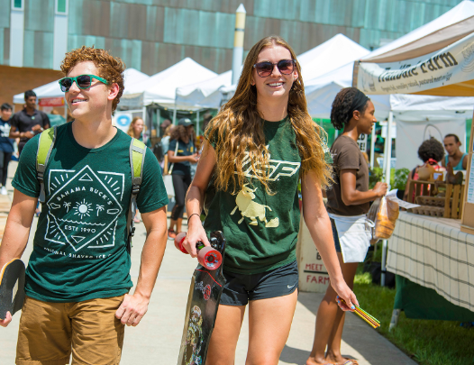 Two USF students walking through Bull Market at USF Tampa campus.