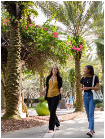 USF employee and student talking and walking around the USF Tampa campus.