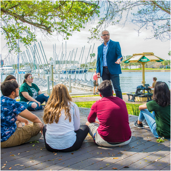 USF professor teaching students outside at the USF St. Petersburg campus.