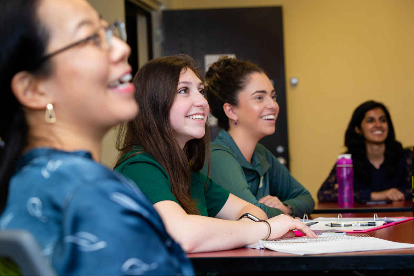 Group of female USF students participating in student success resources on campus.
