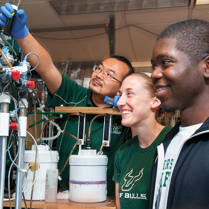 USF students conducting an experiment in their class on the USF's Tampa campus.