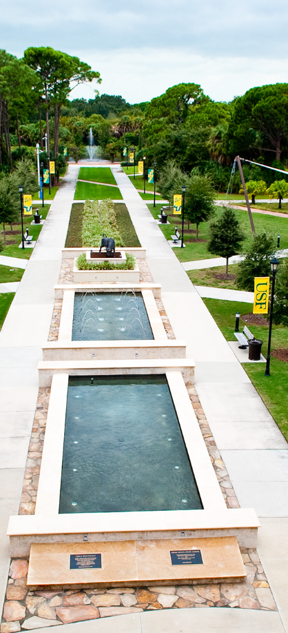 View of USF Sarasota-Manatee campus with fountains and walkways.